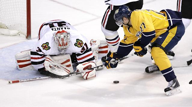 Chicago Blackhawks goalie Antti Raanta (31), of Finland, stops a shot by Nashville Predators forward Patric Hornqvist (27), of Sweden, during the second period of an NHL hockey game Saturday, April 12, 2014, in Nashville, Tenn. (AP Photo/Mark Humphrey)