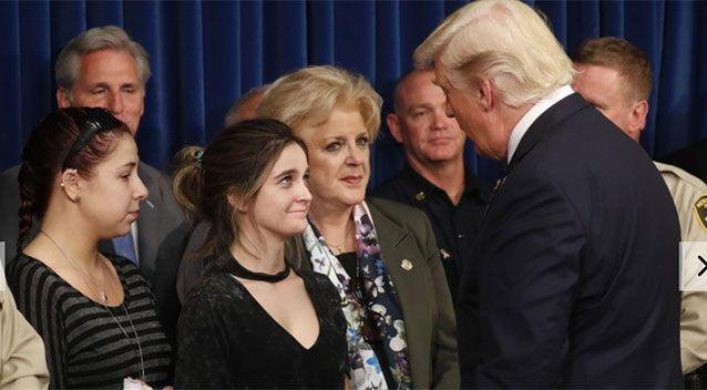 Donald Trump is greeted by survivor family members Shelby Stalker and Stephanie Melanson. Source: Reuters