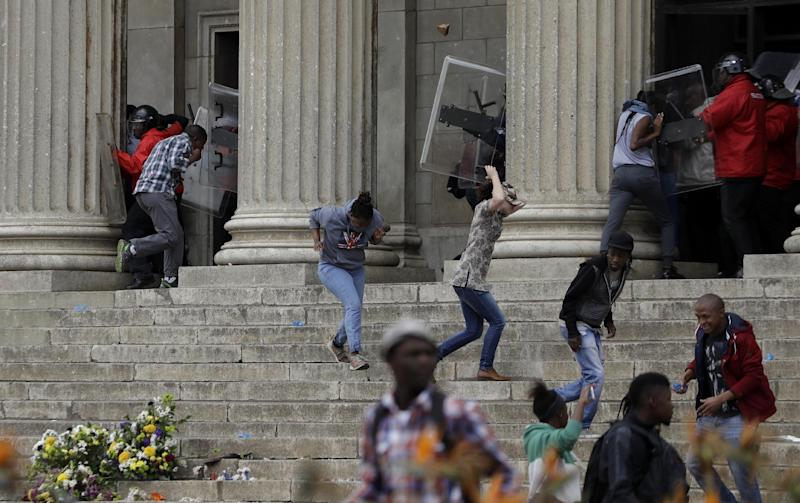 South African police fire stun grenades as students protest