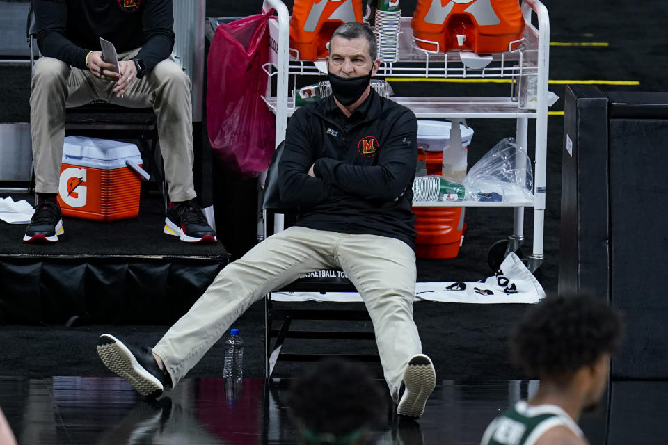 Maryland head coach Mark Turgeon sits on the bench as his team plays against Michigan State in the first half of an NCAA college basketball game at the Big Ten Conference tournament in Indianapolis, Thursday, March 11, 2021. (AP Photo/Michael Conroy)
