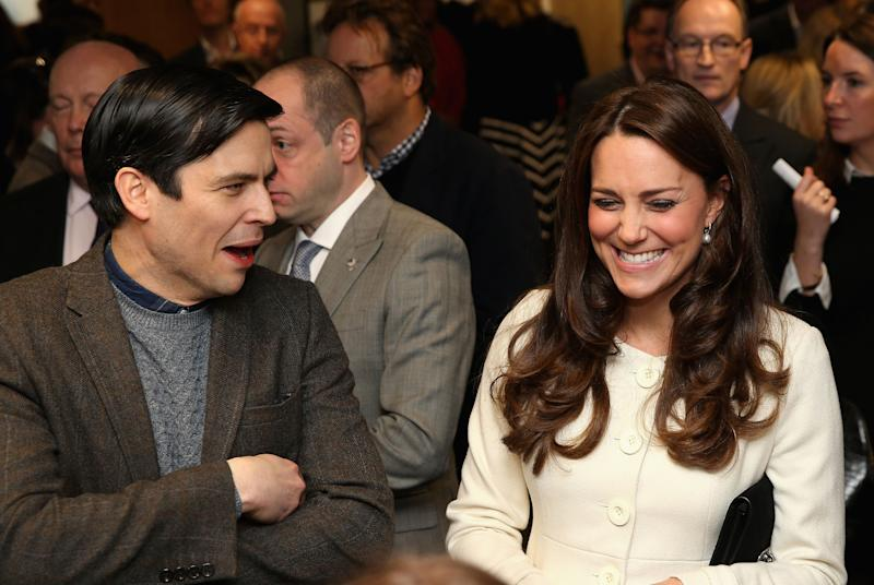 The Duchess of Cambridge shares a joke with actor Robert James-Collier (Thomas) during an official visit to the set of Downton Abbey at Ealing Studios in London.