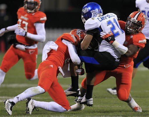 Buffalo running back Devin Campbell, center, is tackled by Bowling Green's Cameron Truss, left, and D.J. Lynch during the fourth quarter of an NCAA college football game Friday, Nov. 23, 2012, in Columbus, Ohio. Bowling Green beat Buffalo 21-7. (AP Photo/Jay LaPrete)