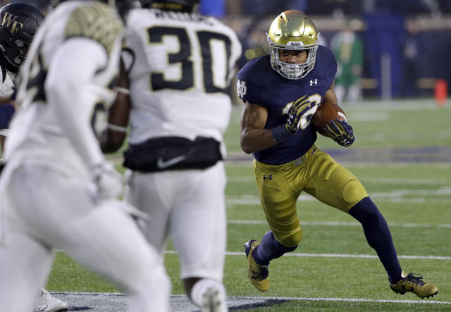 "Notre Dame running back <a class=""link rapid-noclick-resp"" href=""/ncaaf/players/271140/"" data-ylk=""slk:Deon McIntosh"">Deon McIntosh</a>, was one of four Notre Dame players dismissed Tuesday. (AP Photo/Nam Y. Huh)"