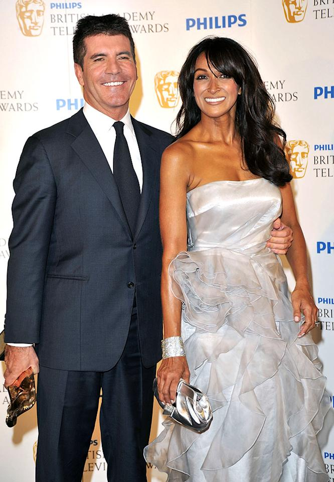 LONDON, ENGLAND - JUNE 06:  Simon Cowell (L) and Jackie St Clair pose in the press room at the Philips British Academy Television Awards (BAFTA) at London Palladium on June 6, 2010 in London, England.  (Photo by Jon Furniss/WireImage) *** Local Caption *** Simon Cowell;Jackie St Clair