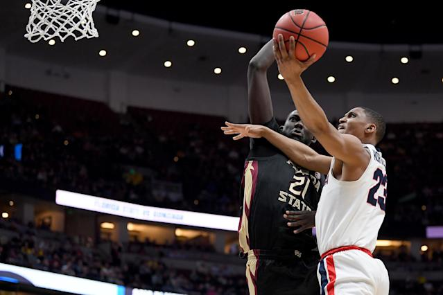 <p>Zach Norvell Jr. #23 of the Gonzaga Bulldogs drives to the basket against Christ Koumadje #21 of the Florida State Seminoles during the 2019 NCAA Men's Basketball Tournament West Regional at Honda Center on March 28, 2019 in Anaheim, California. (Photo by Harry How/Getty Images) </p>