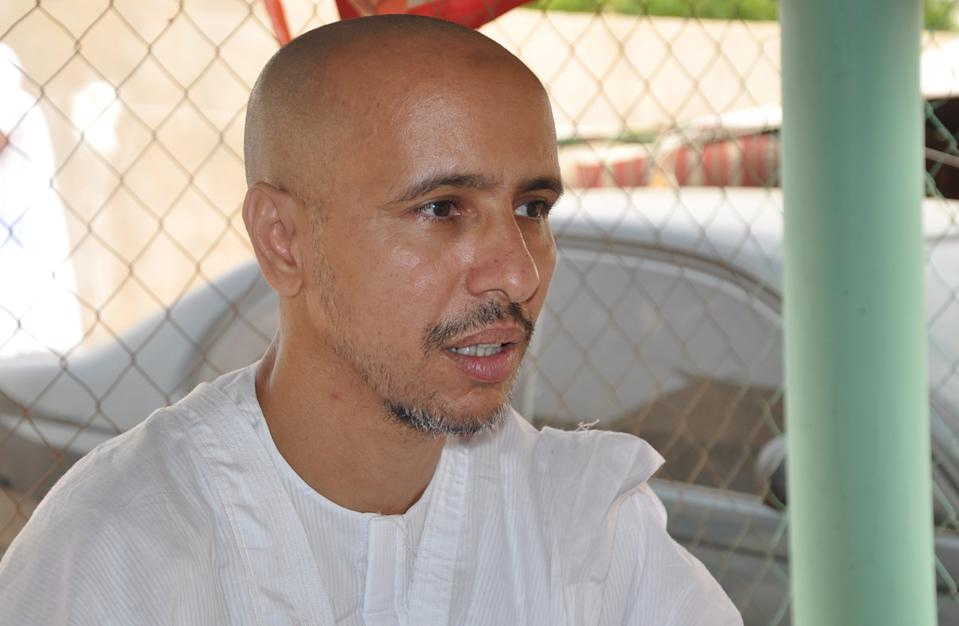 Mohamedou Ould Slahi, a Guantanamo Bay prisoner who wrote a best-selling book about his experiences in the military prison, poses on October 18, 2016 in Nouakchott, after he was reunited with his family in his native Mauritania on October 17 after 14 years of detention   The transfer of Mohamedou Ould Slahi, believed to be the last inmate from Mauritania held at the facility in Cuba, brings the prison's remaining population down to 60. His case became a cause celebre after the publication last year of