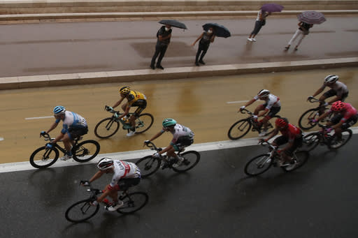 The pack rides during the first stage of the Tour de France cycling race over 156 kilometers (97 miles) with start and finish in Nice, southern France, Saturday, Aug. 29, 2020. (AP Photo/Christophe Ena)