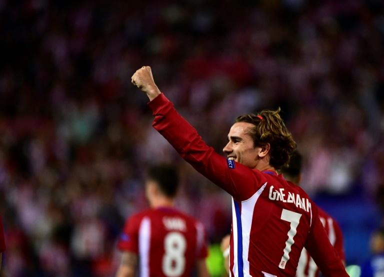 Atletico Madrid's forward Antoine Griezmann celebrates a penalty goal during the UEFA Champions League quarter final first leg football match against Leicester City April 12, 2017