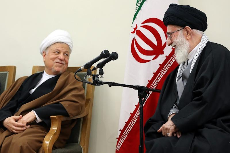 A picture released on March 12, 2015 shows Akbar Hashemi Rafsanjani with Iran's supreme leader Ayatollah Ali Khamenei (AFP Photo/)