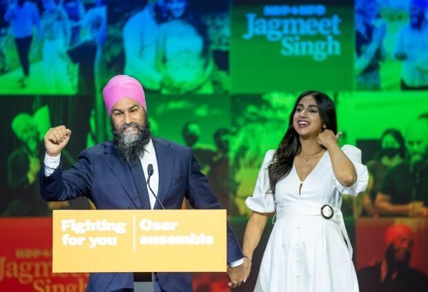 NDP Leader Jagmeet Singh and his wife, Gurkiran Kaur Sidhu, arrive on stage to deliver his concession speech at his election night headquarters in Vancouver on Monday. (Jonathan Hayward/The Canadian Press - image credit)