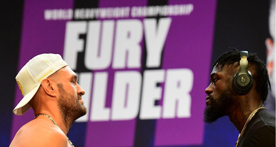 Boxers Tyson Fury (L) and Deontay Wilder (R) face off at a press conference on June 15, 2021 in Los Angeles, California to announce their third WBC heavyweight championship ficght scheduled for July 24 in las Vegas. (Photo by Frederic J. BROWN / AFP) (Photo by FREDERIC J. BROWN/AFP via Getty Images)