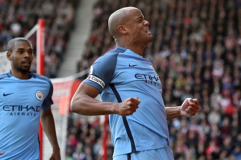 Manchester City's defender Vincent Kompany celebrates after scoring the opening goal of the English Premier League football match between Southampton and Manchester City at St Mary's Stadium in Southampton, southern England on April 15, 2017