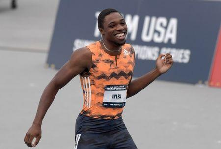 Jun 22, 2018; Des Moines, IA, USA; Noah Lyles left) reacts after defeating Ronnie Baker (not pictured) to win the 100m, 9.88 to 9.90, during the USA Championships at Drake Stadium. Bryce Robinson (right) was seventh in 10.55. Mandatory Credit: Kirby Lee-USA TODAY Sports