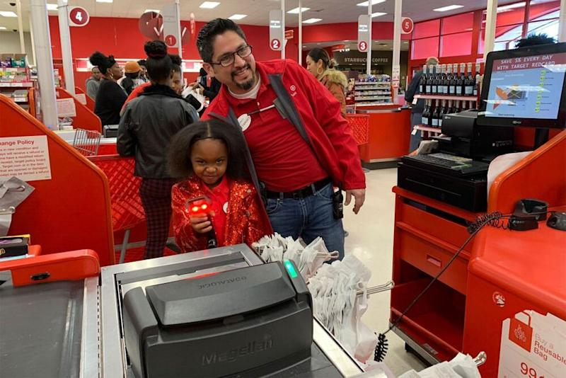Brayden Lawrence with a Target employee | Rikki Jackson; Bailey Lawrence
