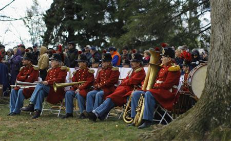 Members of President Lincoln's Own Band from Kentucky listen to speeches at the Gettysburg National Cemetery in Pennsylvania November 19, 2013, the burial ground for Civil War Union soldiers in which U.S. President Abraham Lincoln travelled to in 1863 to deliver a few concluding remarks at a formal dedication. REUTERS/Gary Cameron