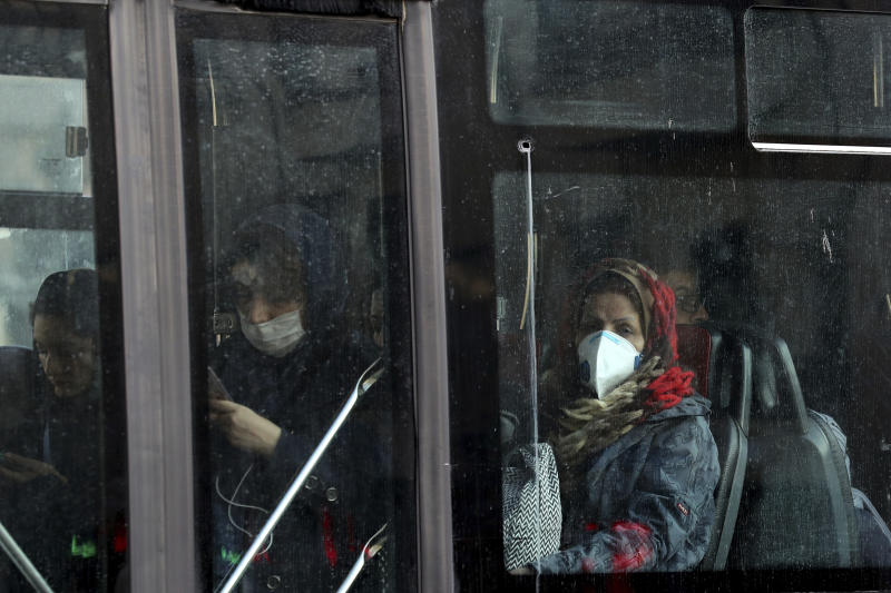 People wear masks to help guard against dangerous levels of air pollution in Tehran, Iran, Monday, Dec. 23, 2019. Poor air quality forced Iran's government on Monday to keep all schools closed in the capital, Tehran, and other cities. Schools were closed since Saturday, and will remain closed until Wednesday, the end of the week in Iran, according to the official IRNA news agency. Tehran's air is among the most polluted in the world. (AP Photo/Ebrahim Noroozi)