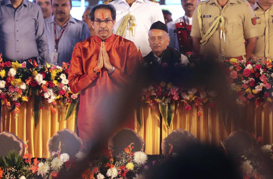 Shiv Sena party leader Uddhav Thackeray greets supporters after taking oath as chief minister of Maharashtra state during a swearing-in-ceremony in Mumbai, Thursday, Nov. 28, 2019. Supporters of the Shiv Sena, Nationalist Congress Party (NCP) and the Congress party thronged Shivaji Park to watch their leaders take oath of office. (AP Photo/Rafiq Maqbool)