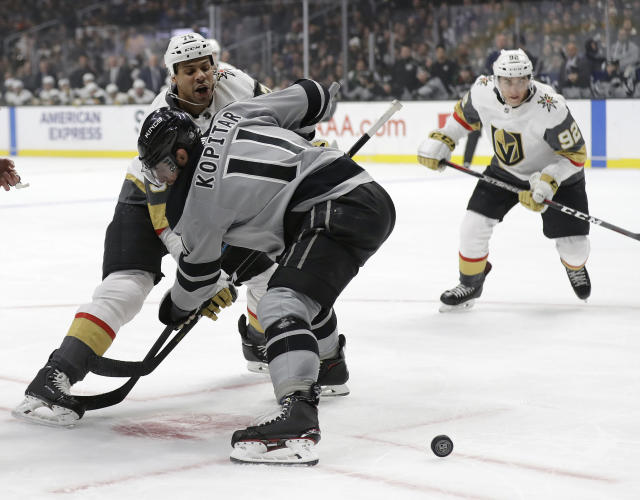 Vegas Golden Knights' Ryan Reaves, left, faces off against Los Angeles Kings' Anze Kopitar during the first period of an NHL hockey game Saturday, Dec. 29, 2018, in Los Angeles. (AP Photo/Marcio Jose Sanchez)