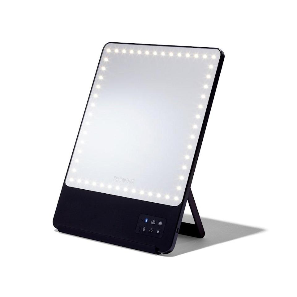 """With five different kinds of LED light dimming and a magnetic phone clip for—wait for it—a custom Bluetooth selfie function, this <a href=""""https://www.glamour.com/gallery/best-lighted-makeup-mirror?mbid=synd_yahoo_rss"""" rel=""""nofollow noopener"""" target=""""_blank"""" data-ylk=""""slk:lighted makeup mirror"""" class=""""link rapid-noclick-resp"""">lighted makeup mirror</a> is a makeup queen's dream. $190, Riki. <a href=""""https://shop-links.co/1718759259996795599"""" rel=""""nofollow noopener"""" target=""""_blank"""" data-ylk=""""slk:Get it now!"""" class=""""link rapid-noclick-resp"""">Get it now!</a>"""