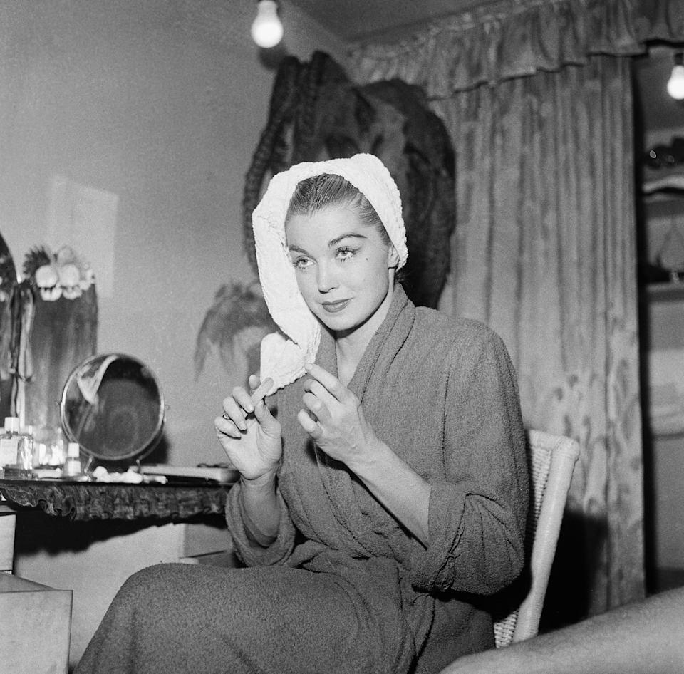 Williams wears a robe in this photo from 1956.