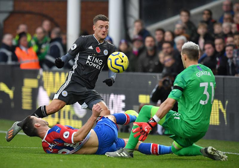 Leicester City's English striker Jamie Vardy (C) vies with Crystal Palace's English defender Gary Cahill (L) and Crystal Palace's Spanish goalkeeper Vicente Guaita during the English Premier League football match between Crystal Palace and Leicester City at Selhurst Park in south London on November 3, 2019. (Photo by Ben STANSALL / AFP) / RESTRICTED TO EDITORIAL USE. No use with unauthorized audio, video, data, fixture lists, club/league logos or 'live' services. Online in-match use limited to 120 images. An additional 40 images may be used in extra time. No video emulation. Social media in-match use limited to 120 images. An additional 40 images may be used in extra time. No use in betting publications, games or single club/league/player publications. / (Photo by BEN STANSALL/AFP via Getty Images)