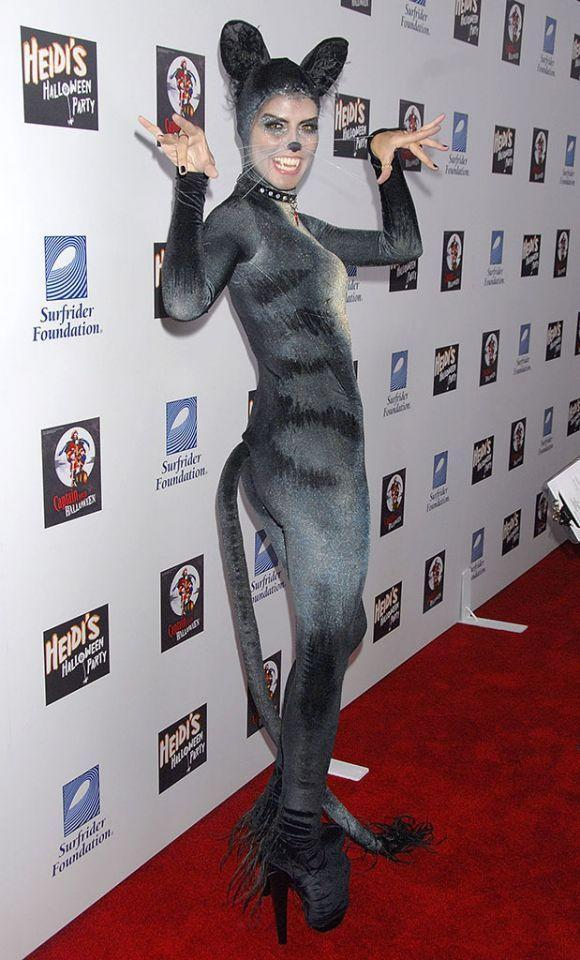 "<p>No. 13: Meow! The star's take on a cat was pretty purrfect in 2007. She showed off her famous figure in the sexy skintight costume, which had some darkness to it thanks to ""Thriller""-type yellow contacts. She paid very close attention to detail, right down to the heart collar, which said, ""If Found, Please Return to Seal,"" a reference to her then-husband, who seemed equally enthusiastic about the holiday when they were together. (Photo: Getty Images) </p>"