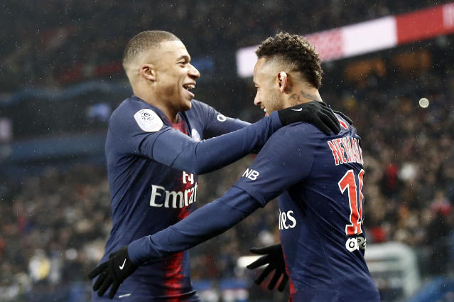 Kylian Mbappe, left, and Neymar had plenty reason to smile on Saturday. (Associated Press)