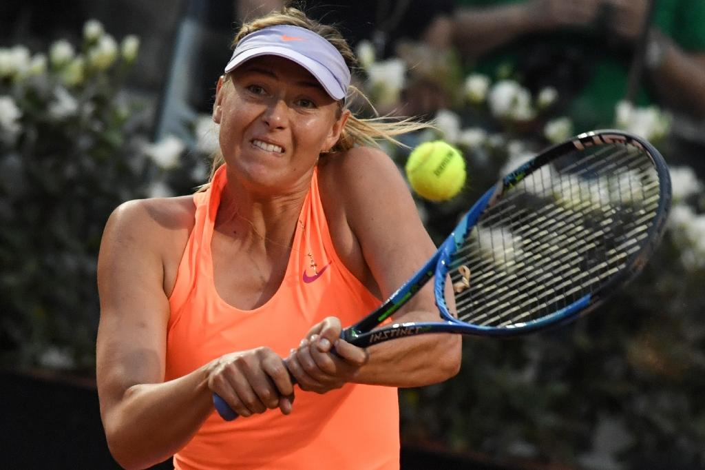 Russia's Maria Sharapova returns to Mirjana Lucic-Baroni of Croatia during their Rome ATP Tennis Open tournament on May 16, 2017 at the Foro Italico in Rome. (AFP Photo/ANDREAS SOLARO)