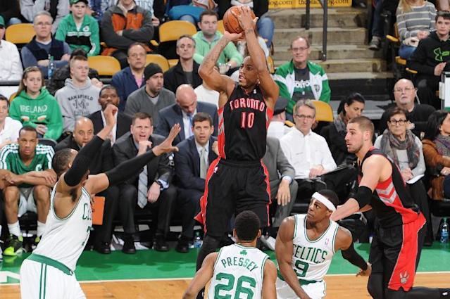 BOSTON, MA - MARCH 26: DeMar DeRozan #10 of the Toronto Raptors shoots against the Boston Celtics on March 26, 2014 at the TD Garden in Boston, Massachusetts. (Photo by Brian Babineau/NBAE via Getty Images)
