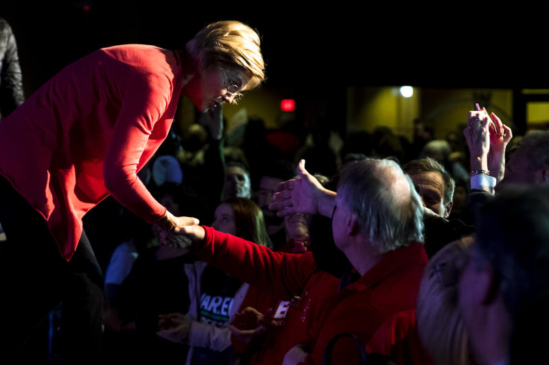 Warren greets attendees during a campaign event in Derry, N.H., on Thursday. (AP Photo/Matt Rourke)