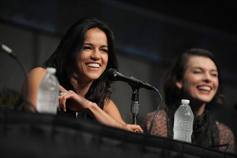 """CORRECTS DATE TO FRIDAY JULY 13 - Michelle Rodriguez and Milla Jovovich attend the """"Resident Evil: Retribution"""" panel at Comic-Con on Friday, July 13, 2012 in San Diego, Calif. (Photo by Jordan Straus/Invision/AP)"""