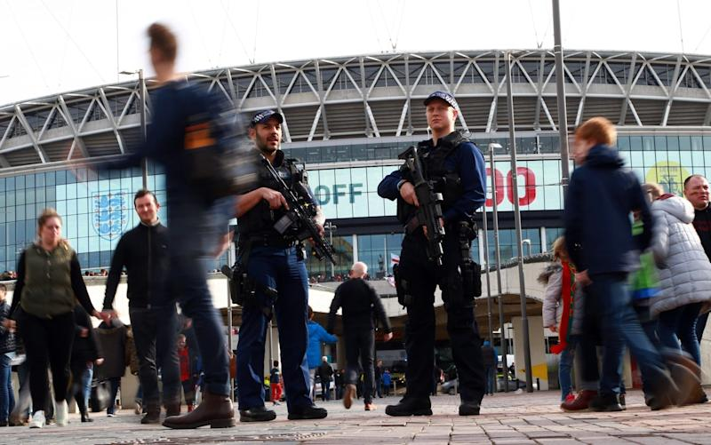 Armed police patrolled outside the national stadium - Rex Features