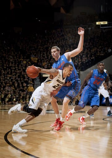 Missouri's Laurence Bowers, left, drives past Florida's Erik Murphy during the first half of an NCAA college basketball game Tuesday, Feb. 19, 2013, in Columbia, Mo. (AP Photo/L.G. Patterson)