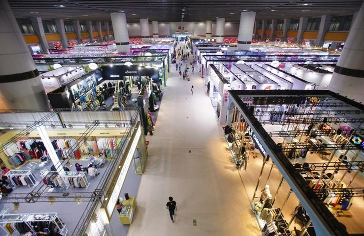 A view shows people visiting different booths at the Guandong Import and Export Fair in Guangzhou