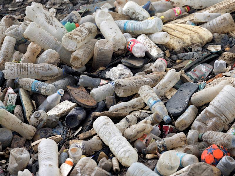 Plastic bottles and other waste are seen in a drain in West Africa