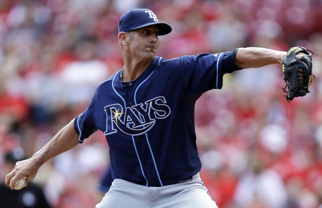 Tampa Bay Rays relief pitcher Grant Balfour throws against the Cincinnati Reds in the ninth inning of a baseball game, Saturday, April 12, 2014, in Cincinnati. Balfour earned his fourth save of the season as Tampa Bay won 1-0. (AP Photo/Al Behrman)