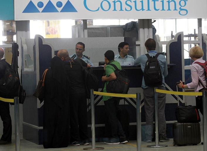 Travelers wait at Sanaa International Airport as hundreds of foreigners were evacuated from the Yemeni capital due to security reasons on March 28, 2015 after the third day of Saudi-led coalition airstrikes against Shiite Huthi rebels (AFP Photo/Mohammed Huwais)
