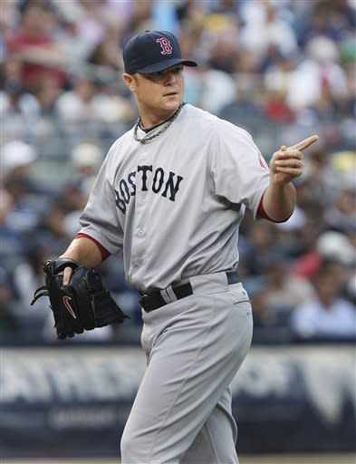 Boston Red Sox pitcher Jon Lester points to a teammate during the first inning of a baseball game against the New York Yankees at Yankee Stadium in New York, Saturday, July 28, 2012. (AP Photo/Seth Wenig)
