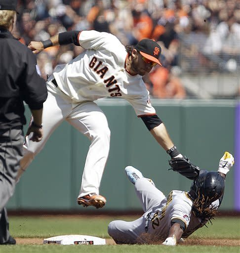 San Francisco Giants shortstop Brandon Crawford tags out Pittsburgh Pirates' Andrew McCutchen during an attempted steal of second base in the third inning of a baseball game Sunday, April 15, 2012, in San Francisco. (AP Photo/Ben Margot)