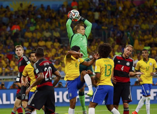 Germany's Manuel Neuer (C, top) makes a save during a Brazil corner kick in their 2014 World Cup semi-finals at the Mineirao stadium in Belo Horizonte July 8, 2014. REUTERS/Eddie Keogh (BRAZIL - Tags: SOCCER SPORT WORLD CUP)