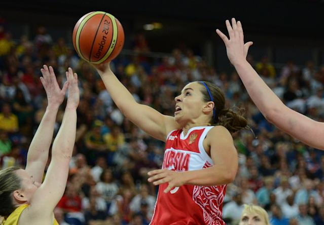 Russian guard Becky Hammon jumps for the ball during the London 2012 Olympic Games women's bronze medal basketball game between Australia and Russia at the North Greenwich Arena in London on August 11, 2012. AFP PHOTO /TIMOTHY A. CLARYTIMOTHY A. CLARY/AFP/GettyImages
