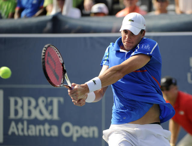John Isner, of the United States, returns a shot to Dudi Sela, of Israel, in the final of the Atlanta Open tennis tournament Sunday, July 27, 2014, in Atlanta. Isner won 6-3, 6-4. (AP Photo/David Tulis)