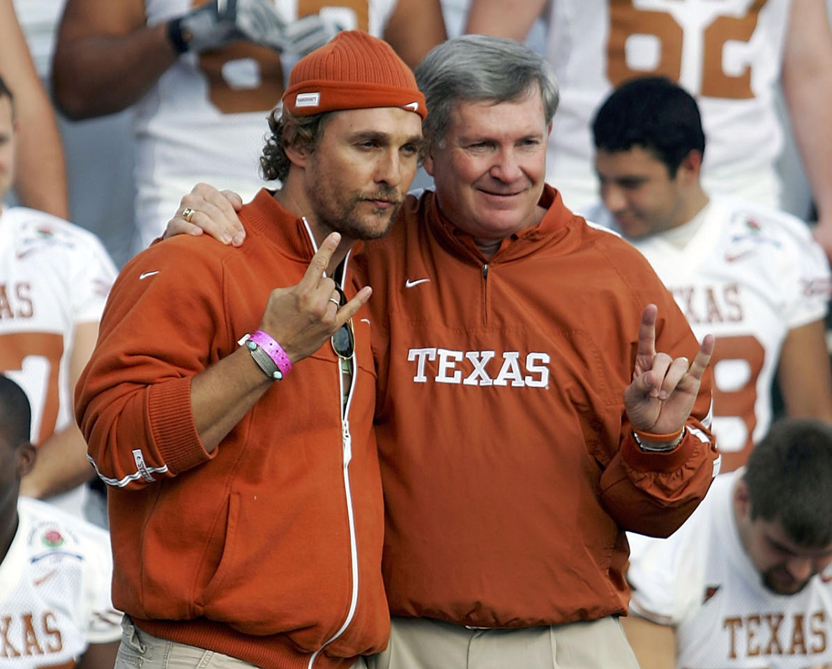 Matthew McConaughey (L) poses with University of Texas head coach Mack Brown (R) during a team photo at the Rose Bowl January 3, 2006 in Pasadena, California.  (Photo by Harry How/Getty Images)