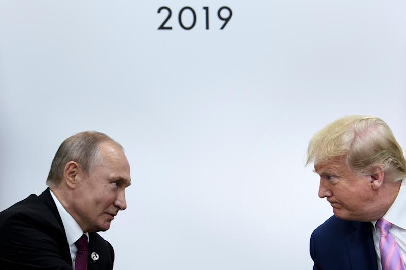 TOPSHOT - US President Donald Trump (R) attends a meeting with Russia's President Vladimir Putin during the G20 summit in Osaka on June 28, 2019. (Photo by Brendan Smialowski / AFP)BRENDAN SMIALOWSKI/AFP/Getty Images ORIG FILE ID: AFP_1HY02G