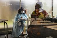 A health worker at Thembisa Hospital, east of Johannesburg, screens visitors for Covid-19 symptoms