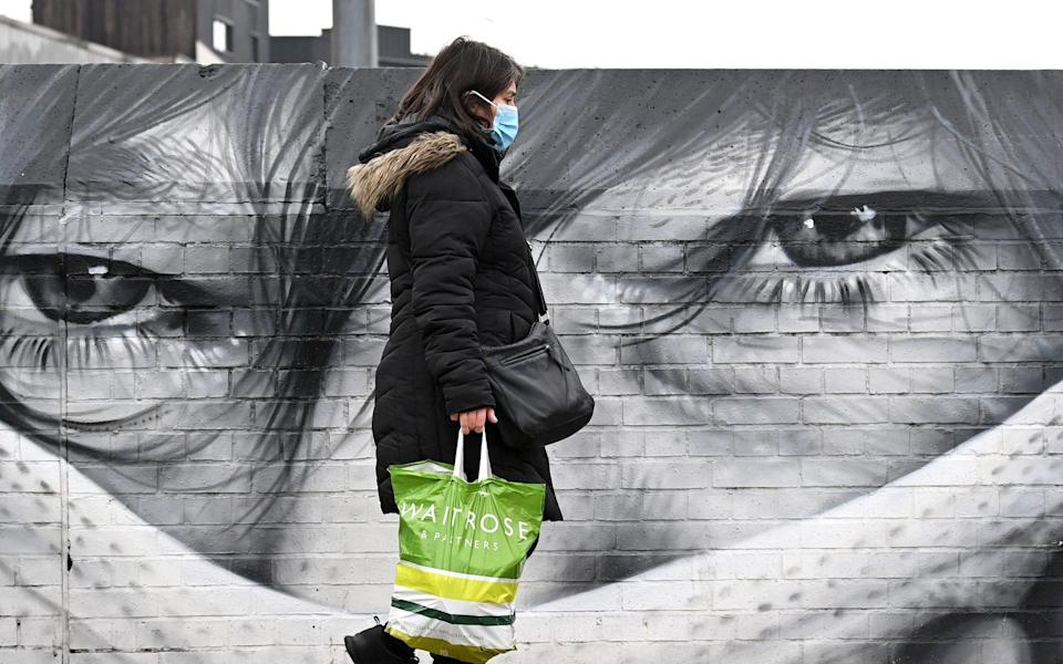 Graffiti in London of a person wearing a face mask - Karwai Tang /Getty Images Europe