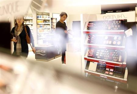Women look at cosmetic products in a Duty Free store at the Fraport airport in Frankfurt November 14, 2012. REUTERS/Lisi Niesner