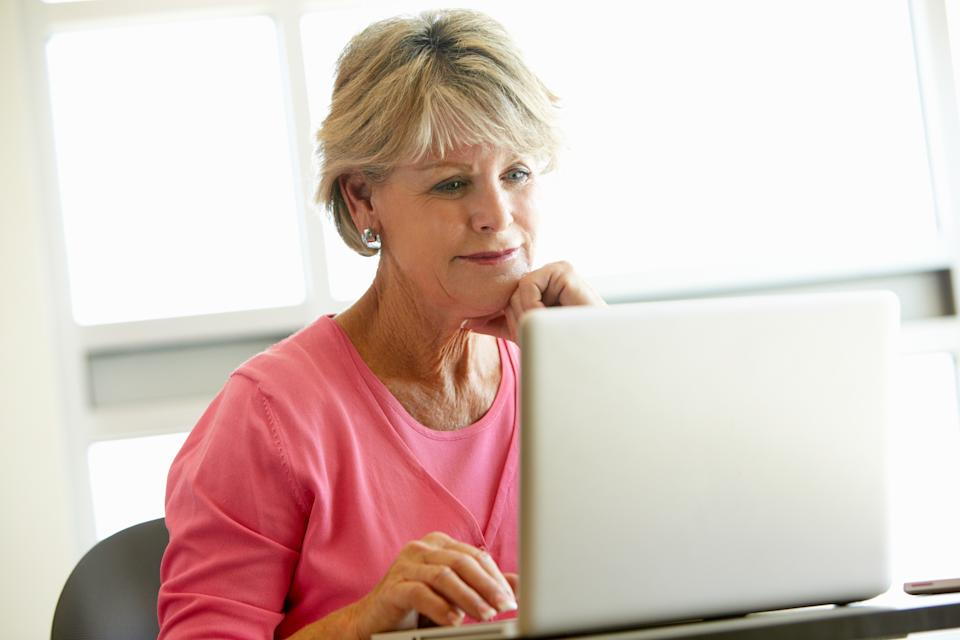 Mature worker using computer to find work