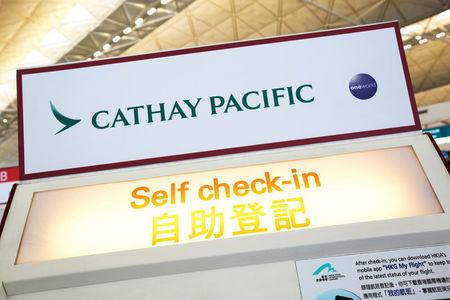 FILE PHOTO A Cathay Pacific self check-in machine is displayed at Hong Kong Airport in Hong Kong