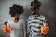 """<p>Looking for a game idea that will have your guests rolling with laughter? Say hello to <a class=""""link rapid-noclick-resp"""" href=""""https://www.popsugar.com/Halloween"""" rel=""""nofollow noopener"""" target=""""_blank"""" data-ylk=""""slk:Halloween"""">Halloween</a> Charades. Come up with a good number of Halloween-themed clues and write them down on tiny pieces of paper. Split your guests into two groups, and take turns with one person acting out each clue for their team. Whichever team has the most points at the end wins. From Halloween candies to scary movies, the options for clues are endless!</p> <p><strong>How to do it while social distancing:</strong> Set up a Zoom call and make sure everyone has their cameras set up so the other people on the call can see them. Since the players can't just grab a scrap of paper like usual, you'll need to have someone sit out of each round so that person can assign the charades to each group without spoiling the game (via text). Once each team has their charades cards, the game can begin!</p>"""